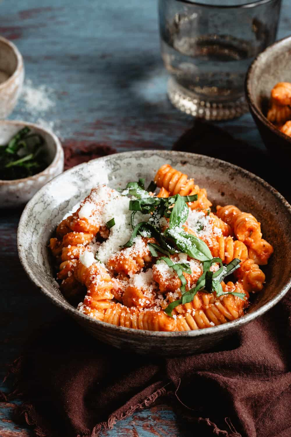 CREAMY RED PEPPER PASTA - INGREDIENTS1 package gluten free pasta of choice1 15-ish oz jar of roasted red peppers1/2 cup cashews OR 1/2 cup full fat coconut milk1/4 cup tomato paste1 onion, roughly chopped3 cloves garlic, mashed or minced2 tb italian seasoning1 tsp sea salt1 tsp crushed black pepper2 tb olive oiloptional: chopped fresh basil, parmesan cheese