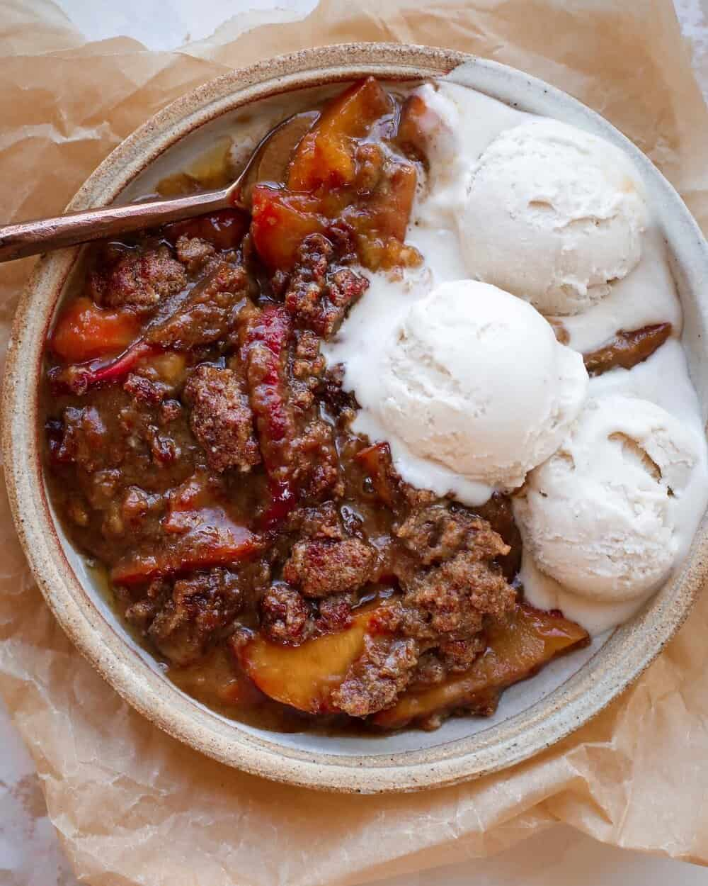 VEGAN PEACH COBBLER - INGREDIENTS4 fresh peaches, cut into slices (if using frozen peaches, use one 12 oz bag and you need 1 tablespoon arrowroot or corn starch or tapioca flour)3/4 cup gluten free flour (or regular flour)1/2 cup coconut sugar1 teaspoon baking powder1/4 cup vegan butter or regular butter, melted1 teaspoon sea saltIce cream to top