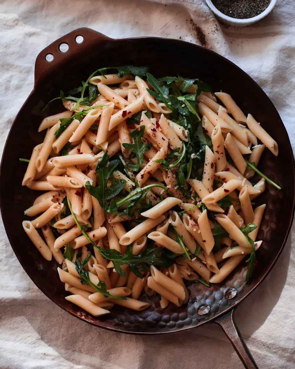 SPICY LEMON ARUGULA PASTA - INGREDIENTS1 16 oz package of penne pasta of choice1/4 cup olive oil6 garlic cloves, mashed1 tsp red chili flakes2-3 cups organic arugula1 lemon, juiced and zested1/2 cup grated parmesan cheese1 tsp sea salt