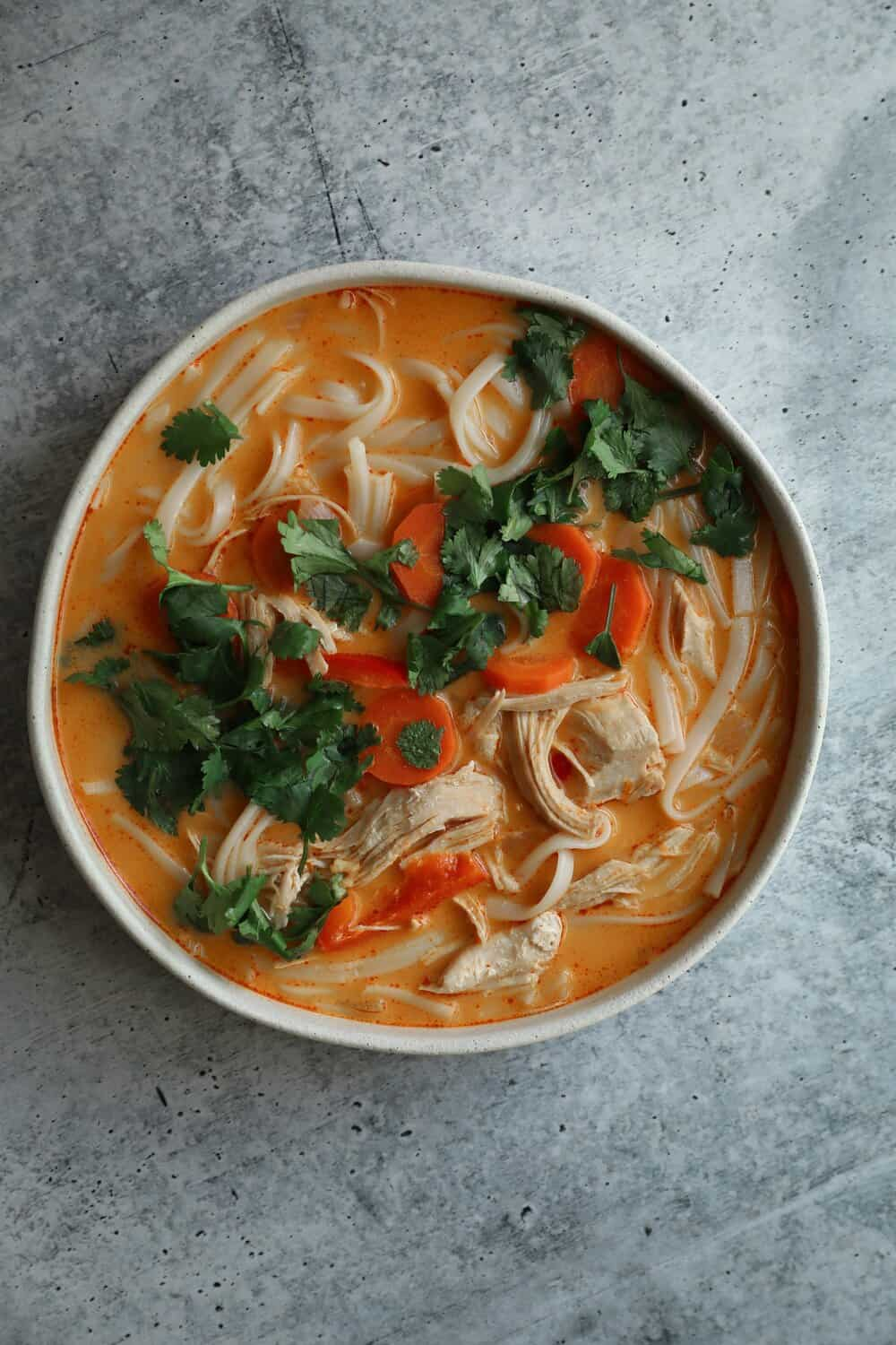 THAI CHICKEN NOODLE SOUP - INGREDIENTS1.5 lbs skinless chicken breast, cubed3 tb coconut oil1 can full fat coconut milk1 8 oz package rice noodles6 cups chicken broth3 tb red curry paste4 cloves garlic, mashed1 onion, diced3 carrots, sliced into coins2 red bell peppers, thinly sliced1 tb ground ginger1 tsp cumin1 bunch cilantro, roughly choppedSalt and pepper to taste