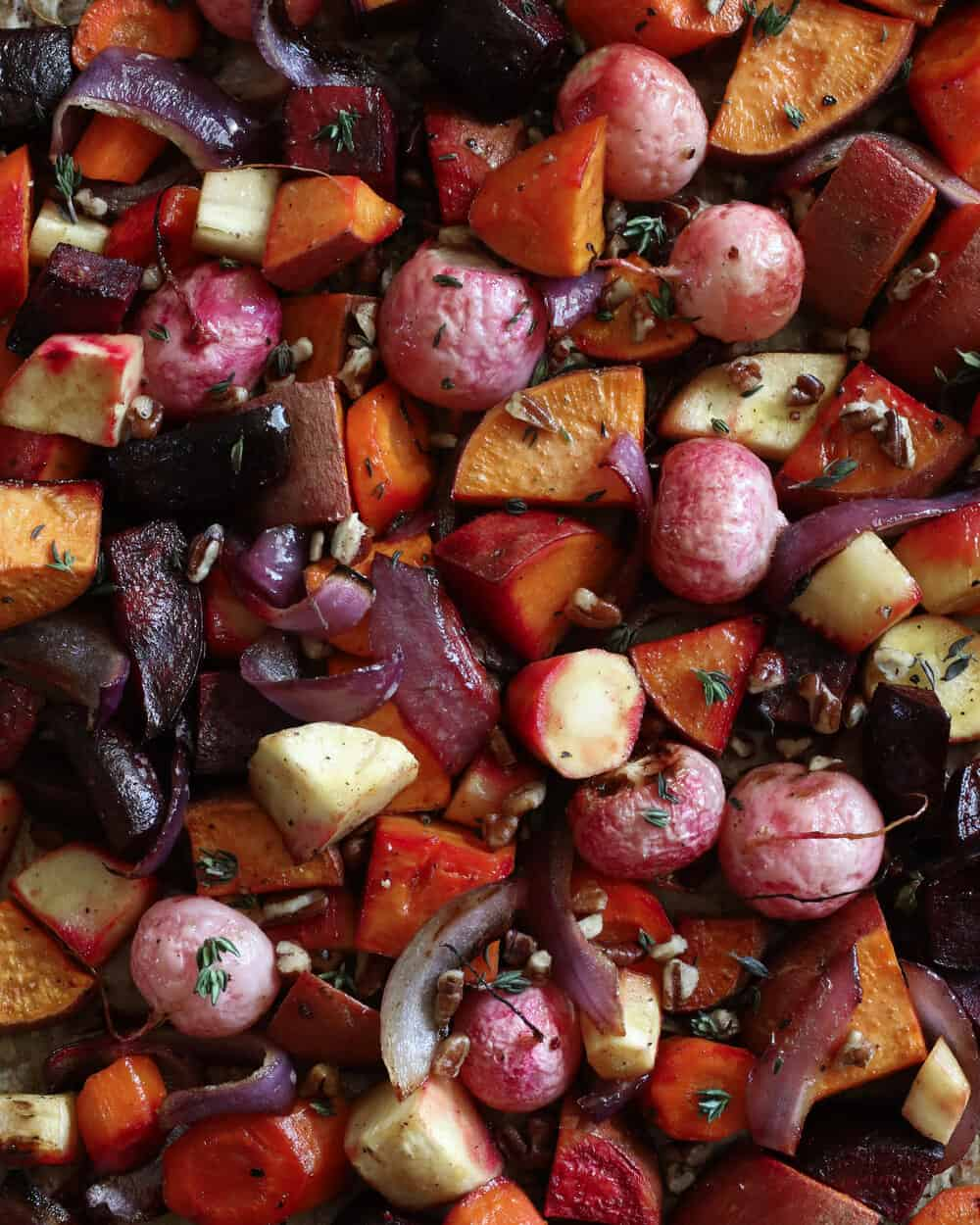MAPLE GLAZED ROASTED ROOT VEGGIES - INGREDIENTS2 parsnips2 carrots1 large beet1 large sweet potato1 large red onion1 bunch radishes1/4 cup olive oil3 tb maple syrup1 tsp apple cider vinegar1 tsp balsamic vinegar2 cloves garlic, mashed1/4 cup chopped walnuts1 sprig fresh thyme (dry is ok too)Salt & pepper to taste