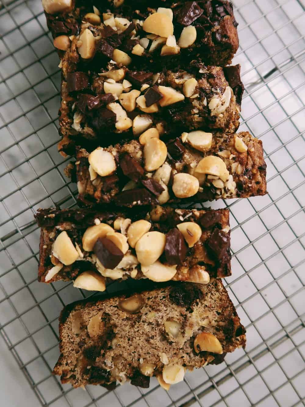CHOCOLATE CHUNK MACADAMIA BANANA BREAD - INGREDIENTS2 large, ripe bananas (if your bananas are small, add a third)1/2 cup almond butter2 eggs1/2 cup coconut flour3/4 tsp baking soda3/4 tsp baking powder1/4 tsp salt1 tsp cinnamon1 cup macadamia nuts, roughly chopped1 chocolate bar (I used Hu Kitchen as it's my ABSOLUTE FAVORITE!)