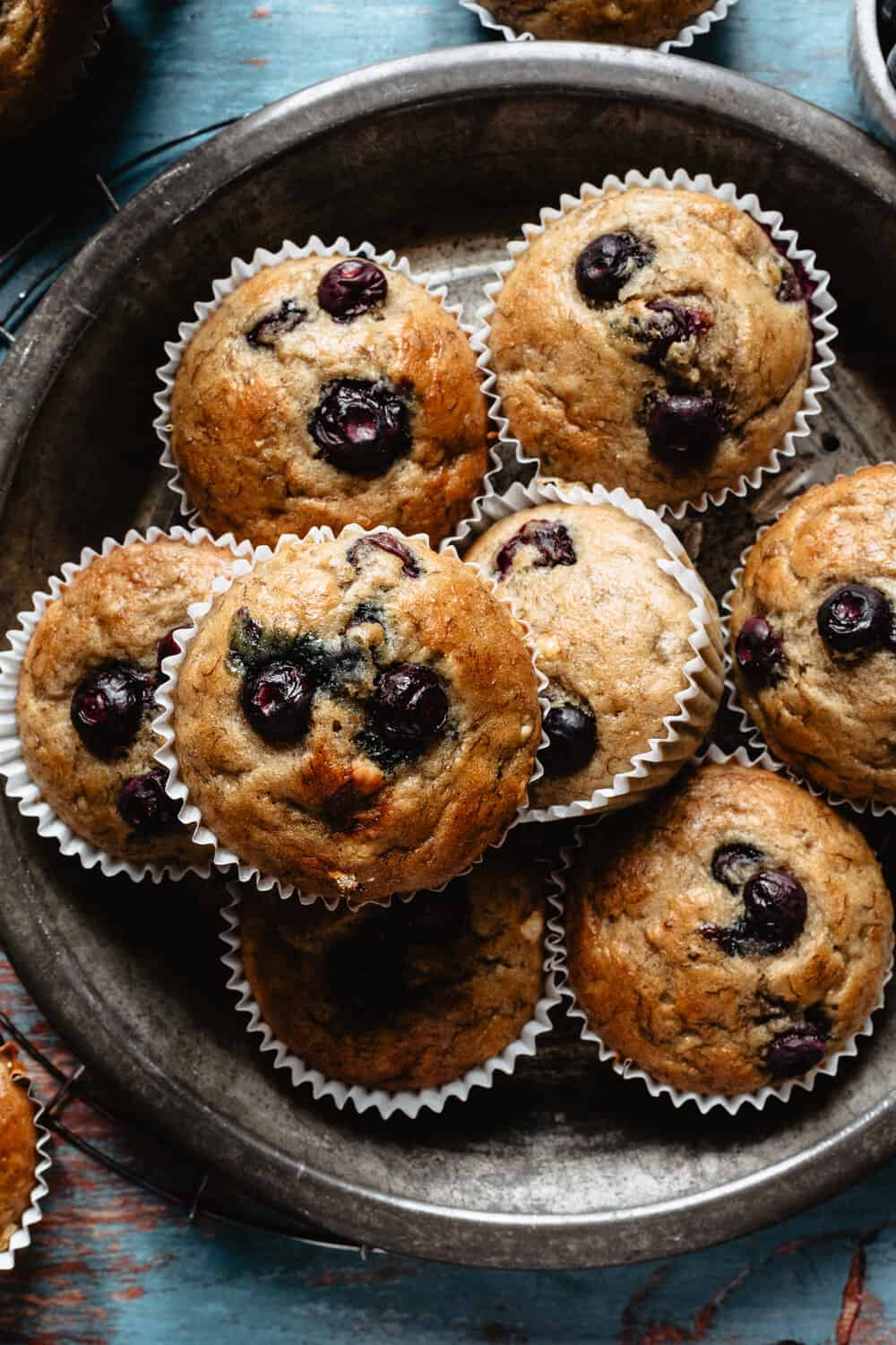 PALEO BLUEBERRY BANANA MUFFINS - INGREDIENTS4 medium bananas (or 3 large)3 organic pasture raised eggs1/4 cup almond flour1/2 cup coconut flour1/4 cup melted coconut oil1/2 cup nut butter of choice (I use almond butter)1 tsp baking powder1 tsp baking soda1 tsp cinnamon3/4 cup fresh blueberries, plus a few more to sprinkle on toppinch of sea salt