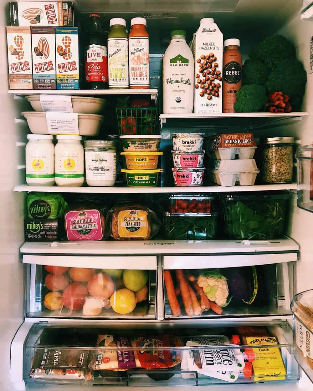 IN THE KALEJUNKIE FRIDGE - There is nothing quite like a refrigerator that is locked, loaded, and ready for the week. My Sunday routine almost always includes a quick fridge clean out, which means taking everything out, placing it on the counter, wiping down the inside, and moving items close to their expiration dates to the front so that we eat them asap. Then I make a list of what items I need to get from the grocery store or farmers market, pile the boys in the car, and get that shopping done. Staying organized in this way helps so that I don't buy more than we need, reducing our overall waste.