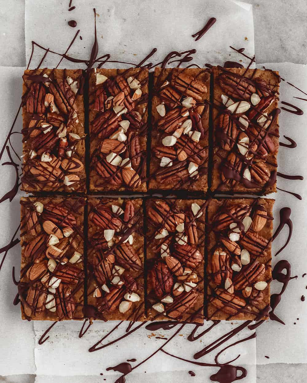 PUMPKIN PIE DESSERT BARS - INGREDIENTSPUMPKIN LAYER:2 cups pecans3/4 cup cashews1/2 cup pumpkin puree8 medjool dates1 tsp cinnamon3 tb non-dairy milkpinch sea saltCHOCOLATE LAYER:3/4 cup cacao powder1/2 cup melted coconut oil3 tablespoons Maple Guild Grade A Maple Syrup